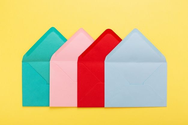 Abstract background with colorful postal envelopes on yellow