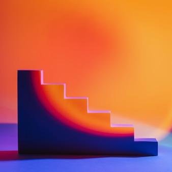 製品のプレゼンテーションのための明るい色の幾何学的な形で抽象的な背景。