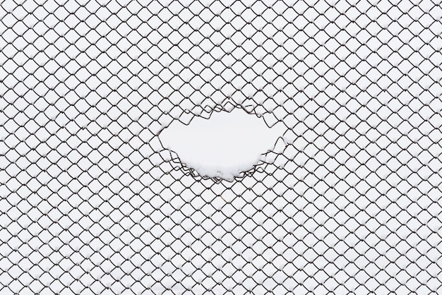 Abstract background with geometric pattern. wire fence in the snow