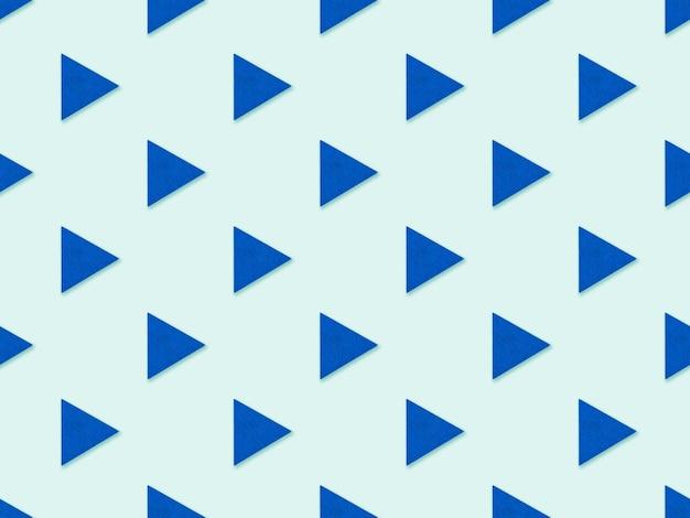 Абстрактный фон с геометрическими фигурами треугольника в пастельных тонах. бесшовный абстрактный узор с изображением геометрических фигур