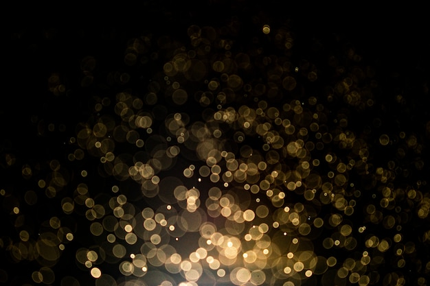 Abstract background with gold bokeh. gold glitter and elegant for christmas background.