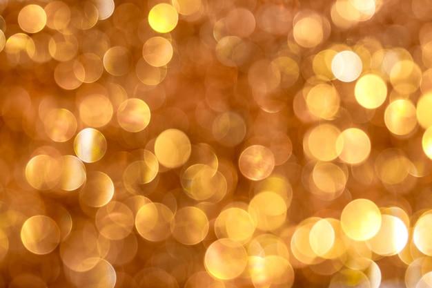 Абстрактный фон с большим боке оранжевого и золотого цветов