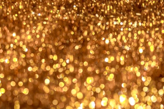 大きなボケオレンジと黄金色の抽象的な背景