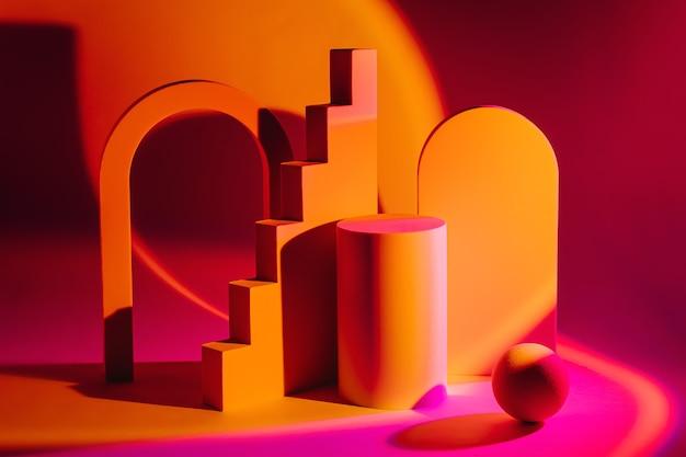 さまざまな幾何学的な形と明るい色の表彰台を持つ抽象的な背景。