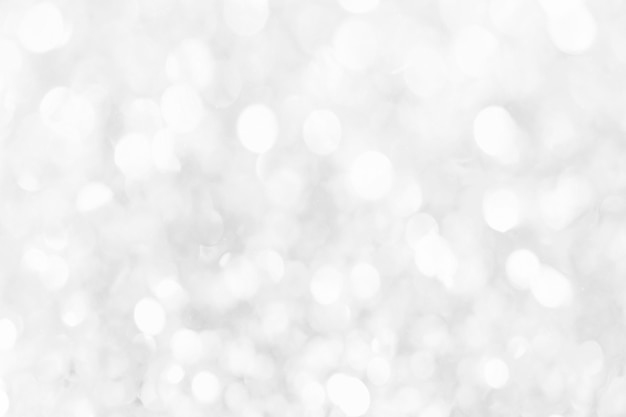 Abstract background with white bokeh lights
