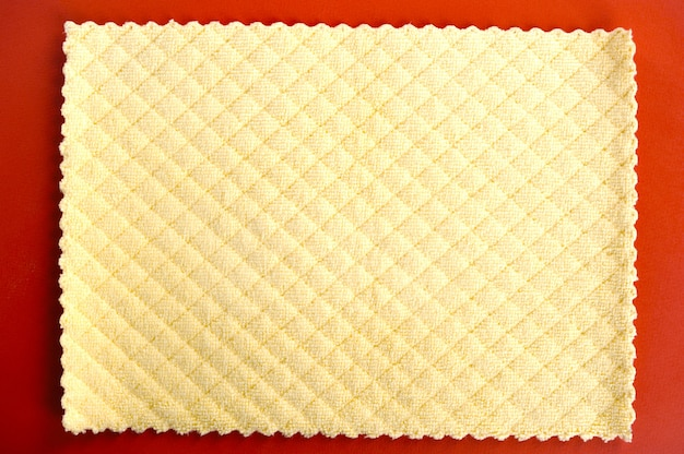 Abstract background   yellow napkin on red background