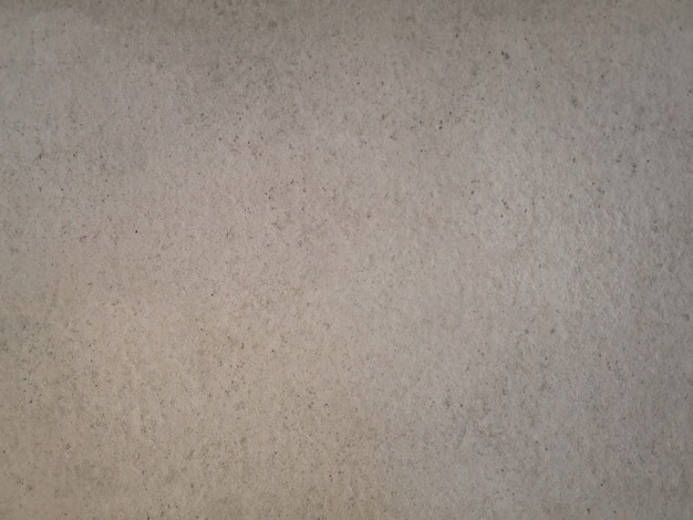 Abstract beige grunge cement wall texture.