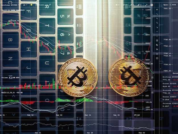 Abstract bitcoin on laptop keyboard bitcoin trading background