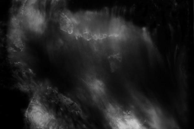 黒と白の抽象的な背景があります。暗いグランジテクスチャ背景。