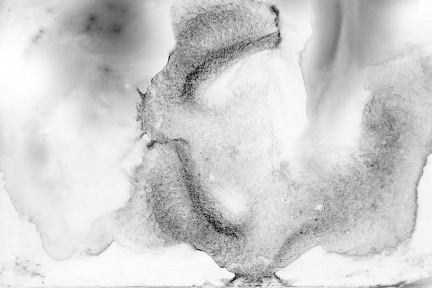 黒と白の抽象的な背景があります。グランジテクスチャ背景。