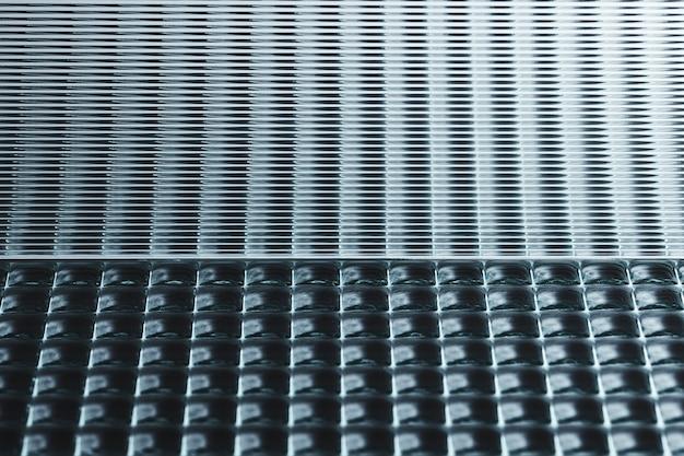 パターン化されたガラスのテクスチャと抽象的な黒の背景