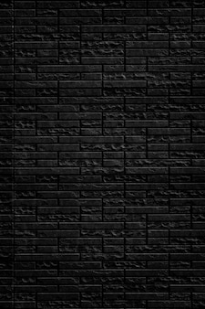 Abstract black brick wall texture background.