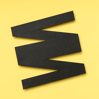 Abstract black geometric linear shape on yellow background