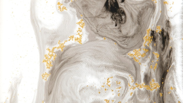 Abstract black watercolor with gold glitter patterned background
