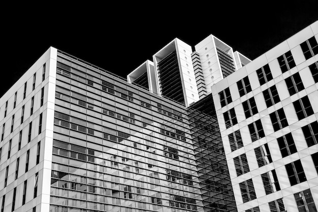 Abstract black and white image of glass skyscraper office buildings