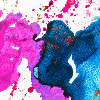 抽象的なブルーとピンクの水彩画の汚れの背景