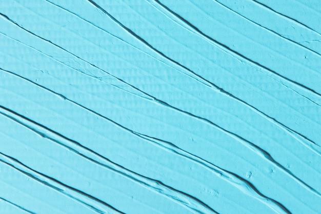 추상 파란색 배경, 줄무늬와 거친 구호 석고의 질감, 평평하다. 여유 공간이있는 배경. 수리, 장식 디자인 컨셉