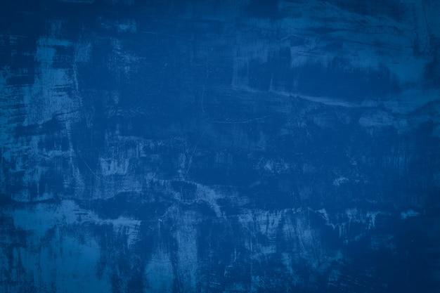抽象的な青いセメントと背景。暗いグランジコンクリートテクスチャ。