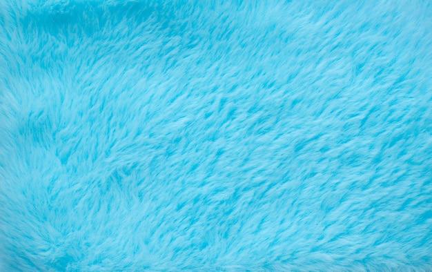 抽象的な青い色のふわふわウールのテクスチャ背景