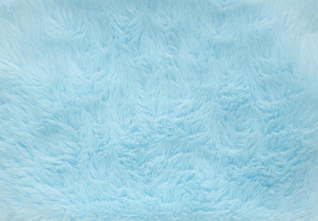 抽象的な青い色のふわふわウール テクスチャ背景