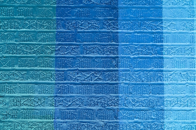 Abstract blue colored brick wall