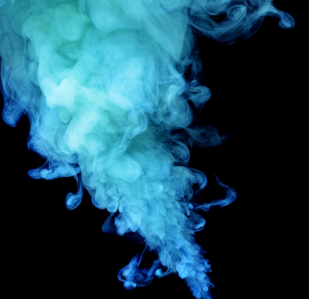 Abstract blue colored smoke on black.