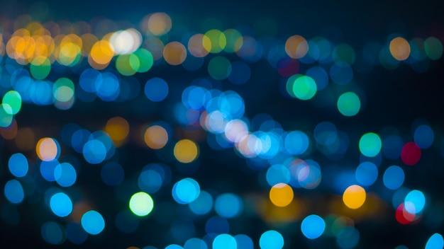 抽象的なブルーダークボケバグラウンドと中粒子