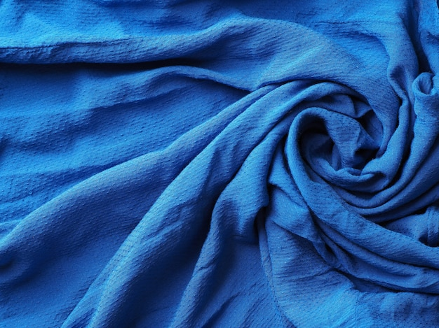 Abstract blue fabric cloth background texture.