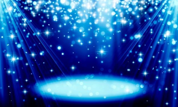 광선과 아스트라가 있는 밝은 보케의 반짝이는 입자로 만들어진 추상 파란색 축제 배경