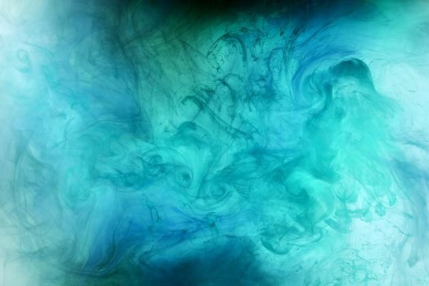 Абстрактный сине зеленый океан, краска в воде фона. водоворот брызг и волн в движении. обои для рабочего стола fluid art, жидкие яркие цвета