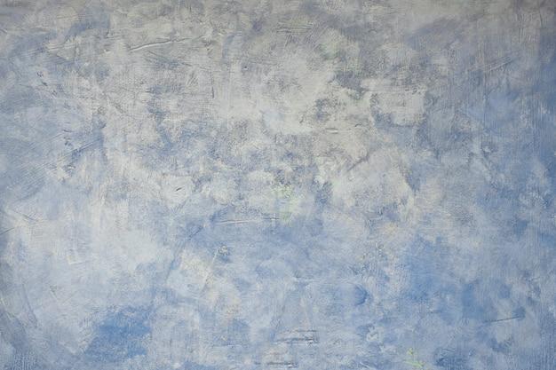 Абстрактный синий гранж-фон с серыми пятнами и царапинами Premium Фотографии