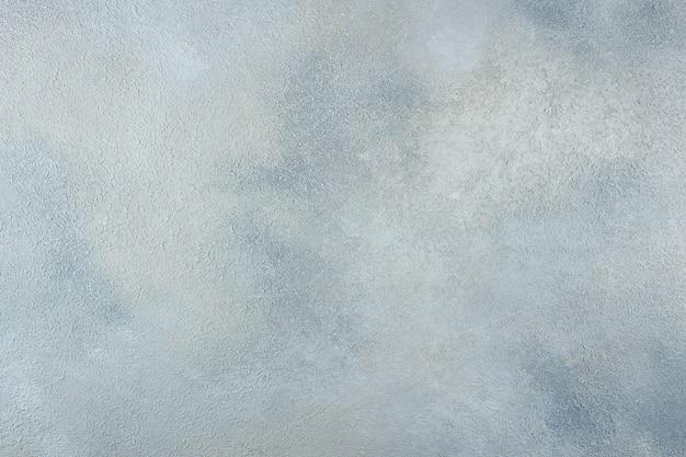 Абстрактная голубая светлая металлическая стена текстуры предпосылки конкретная или гипсолита ручной работы
