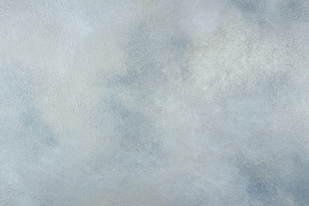 Abstract blue light metallic background texture concrete or plaster hand made wall