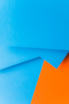 Abstract blue and an orange paper background for greeting cards