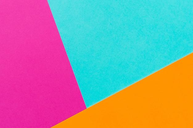 抽象的なブルーピンクとオレンジ色の紙ジオメトリコンポジションの背景。コピースペース。テキスト用の空き容量。