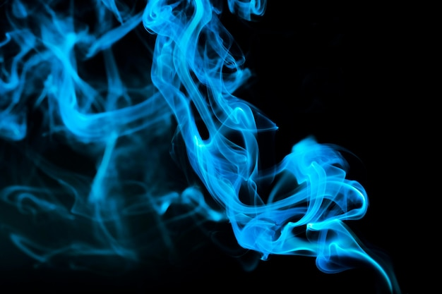 Abstract blue smoke on black.