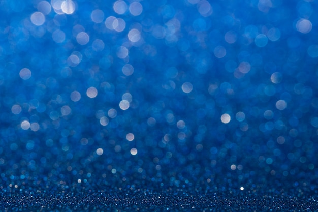 Abstract blue sparkling glitter wall and floor perspective background studio with blur bokeh