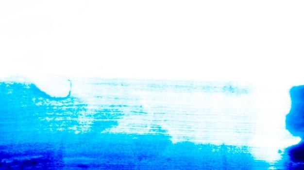 Абстрактный синий удар на бумаге