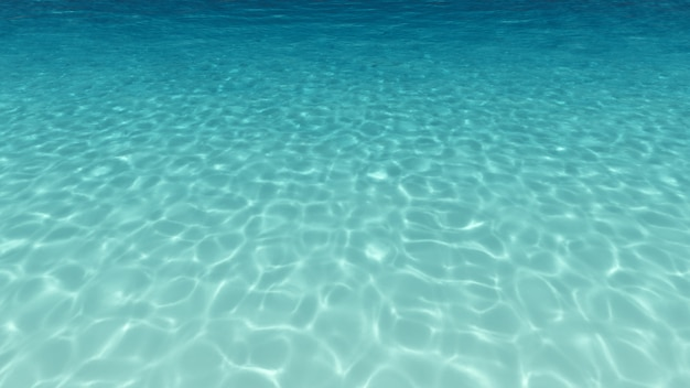Abstract blue water background with sunbeams.