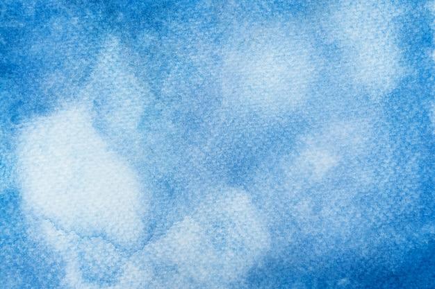 抽象的な青い水彩画の背景。ペイントブラシアートテクスチャの手作りの背景。閉じる。