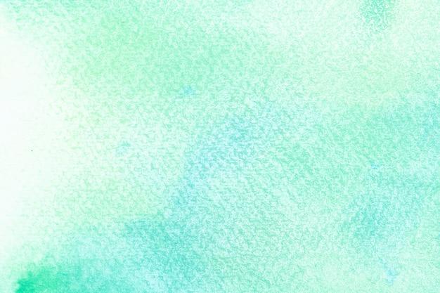 Абстрактная синяя акварель на белом фоне. цвет, брызги в бумаге. это нарисованная рука.