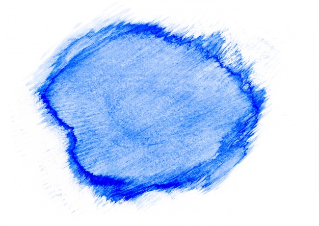 Abstract blue watercolor stain on white paper background. concept of art.
