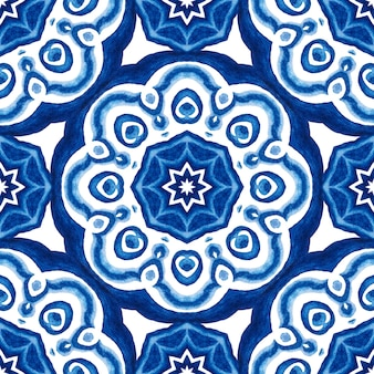 Abstract blue and white hand drawn medallion damask tile seamless ornamental watercolor paint pattern.