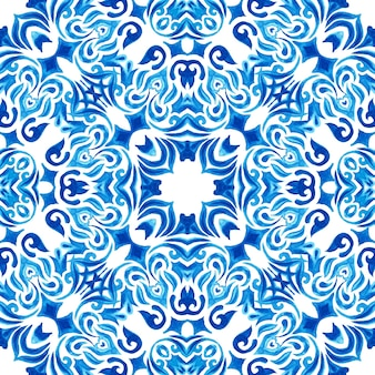 Abstract blue and white hand drawn textured tile seamless ornamental watercolor pattern. elegant old fashioned texture for fabric and wallpapers, backgrounds and page fill. azulejo tile design style