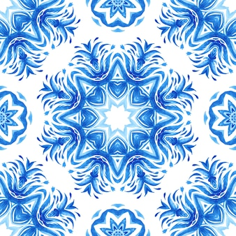 Abstract blue and white hand drawn tile seamless ornamental watercolor paint pattern. elegant mandala medallion texture