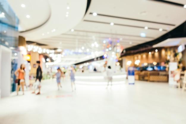 Абстрактное размытие и боке расфокусировали интерьер торгового центра универмага