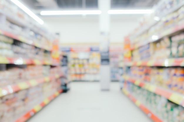 抽象的なぼかしとデパート内のショッピングモールの焦点をぼかし