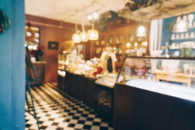 背景の抽象的なぼかしと焦点ぼけのコーヒーショップカフェとレストラン