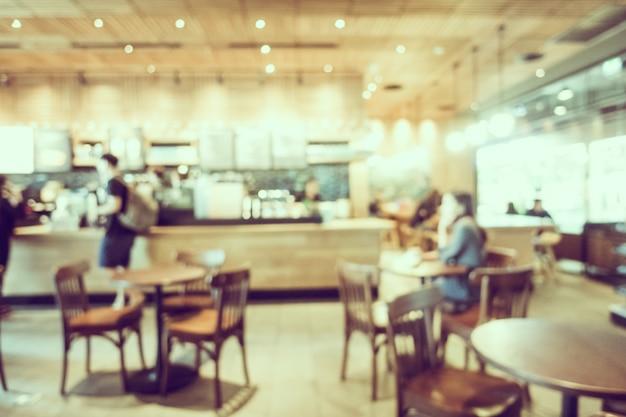 抽象的なぼかしとデフォーカスコーヒーショップカフェのインテリア