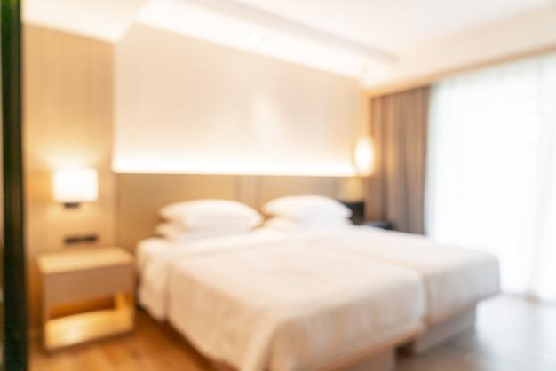 背景の抽象的なぼかしと焦点がぼけたホテルリゾートの寝室